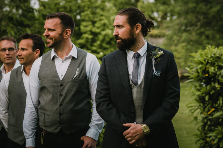 The groomsmen were rocking grey waistcoats, black pants and white shirts