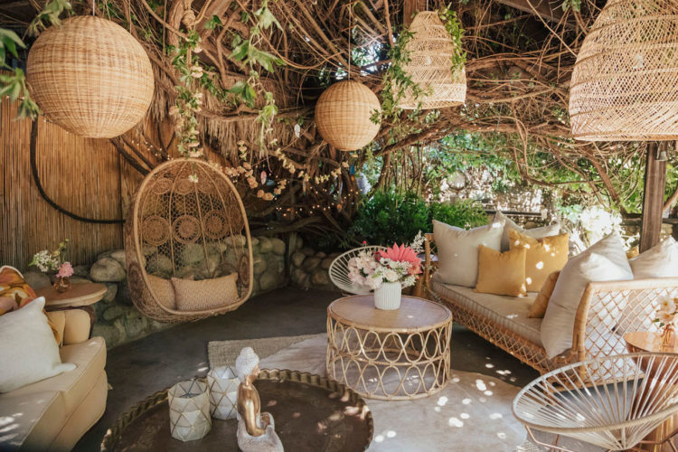 The wedding lounge was totally boho, with wicker touches and rattan furniture