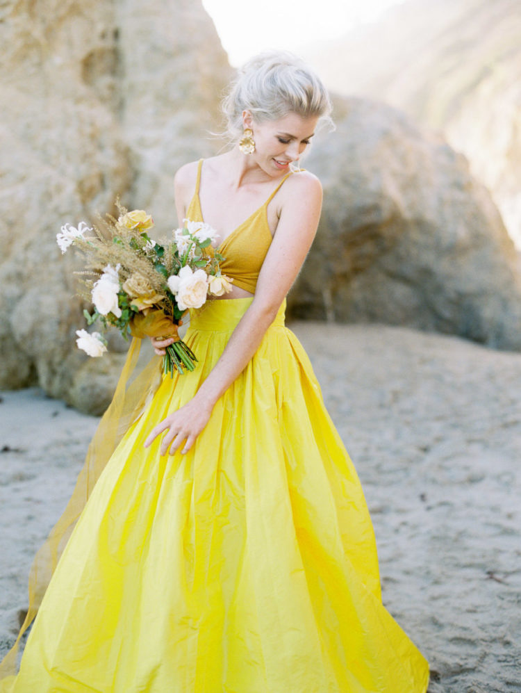 a fashion forward wedding ensemble with a mustard crop top and a sunny yellow full skirt with pleating