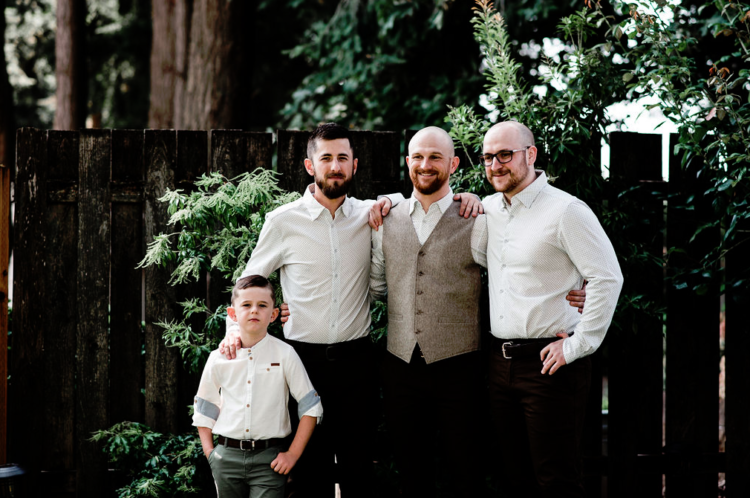 The groom was wearing brown pants, a grey waistcoat, a printed shirt and the groomsmen were rocking the same except for a waistcoat
