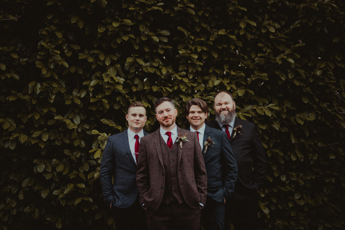 The groomsmen were wearing various tweed suits and red ties