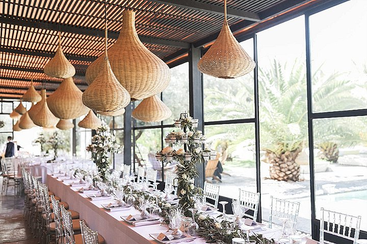 The wedding reception space was done with amazing wicker lamps for a strong Moroccan touch