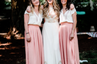 06 The bridesmaids were wearing pink pleated maxi skirts, white tops with embroidery and loose waves