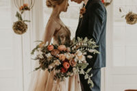 06 The wedding bouquet was lush and textural, with peachy, burgundy, neutral blooms and greenery