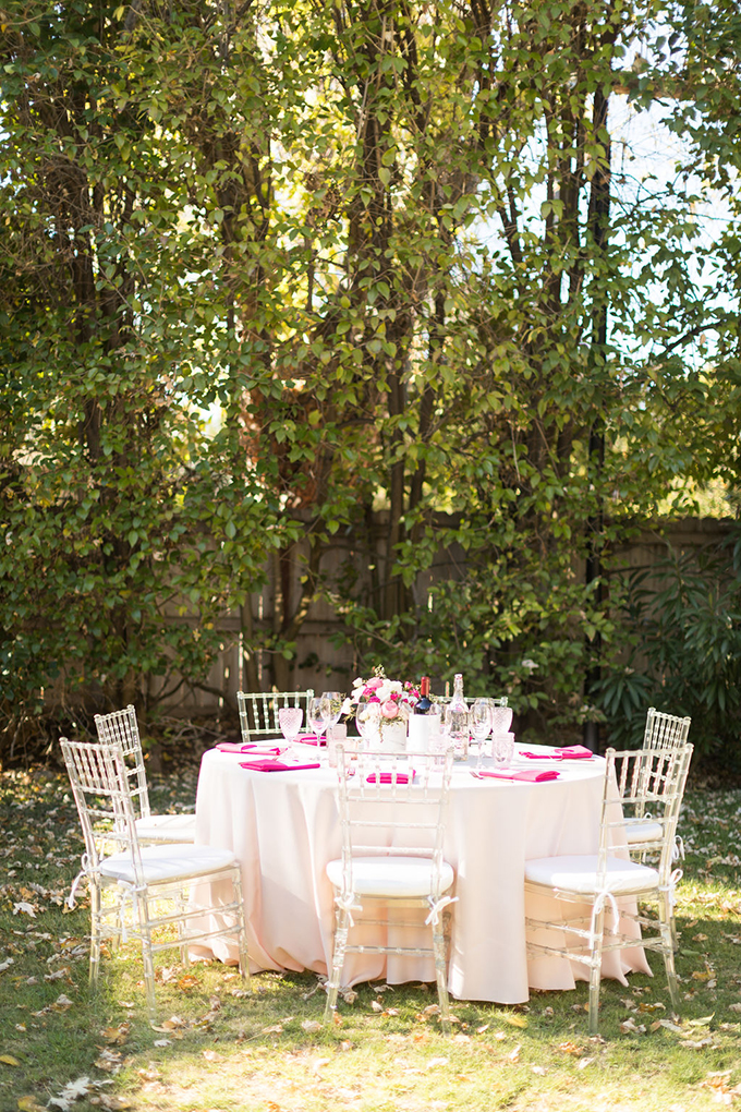 The table was set in creamy, hot pink and blush, with acrylic chairs to give it a more modern look