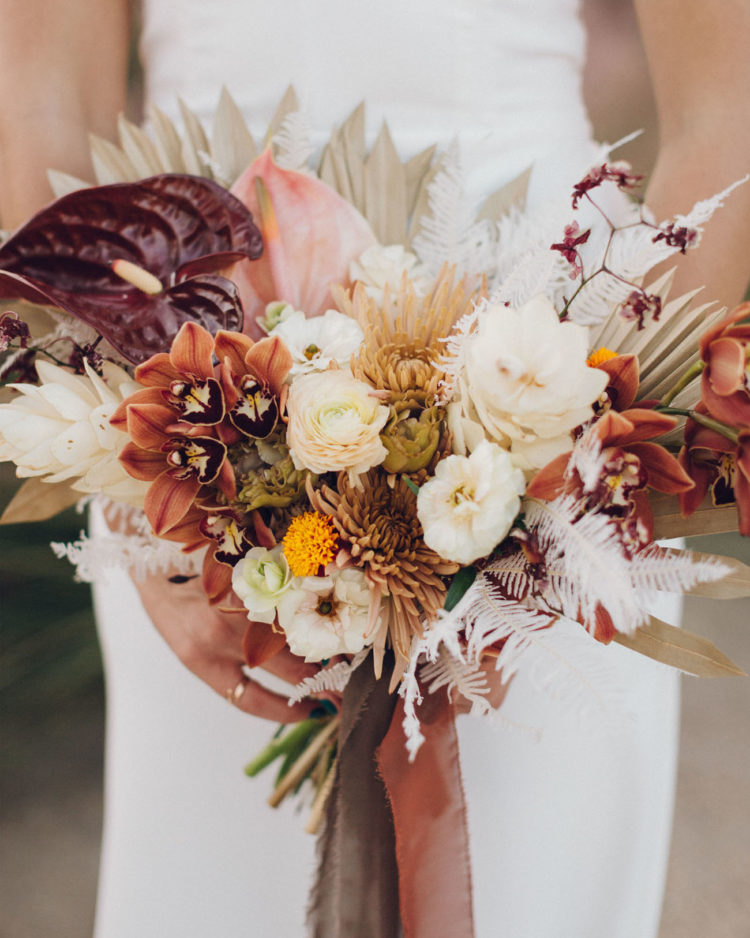 The wedding bouquet was a textural one, with lots of various blooms and dried leaves
