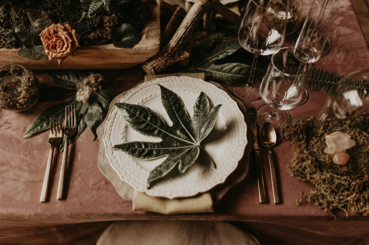 The tablescape was done with greenery, dried looms and herbs, moss, neutrla napkins and simple cutlery