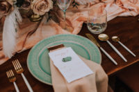 08 Tuquoise plates stood out from the dusty and soft pink shades of the tablescape and gold touches added chic and glam