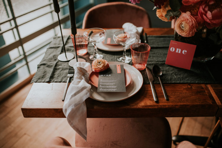 Each place setting was done with a copper plate and glass, a coral bloom and a striped napkin