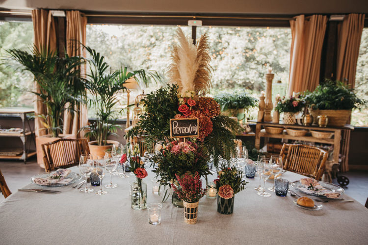 Pampas grass and dried herbs and foliage were used to decorate the tables