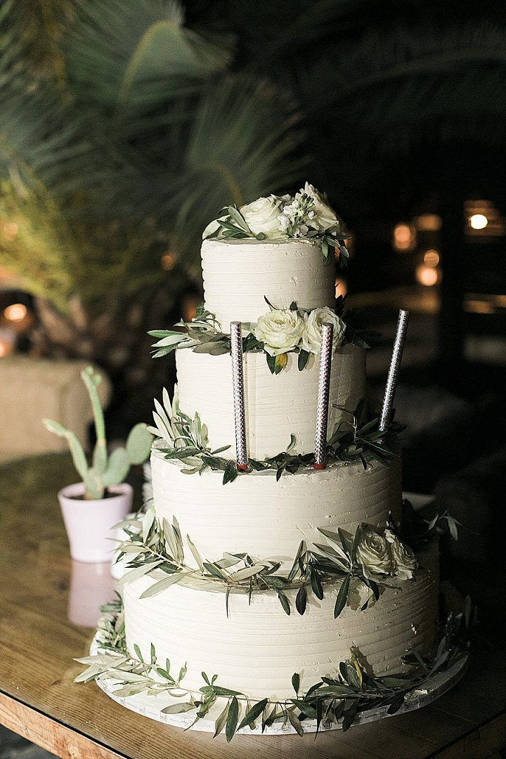 The wedding cake was a buttercream one, with lush greenery and white blooms