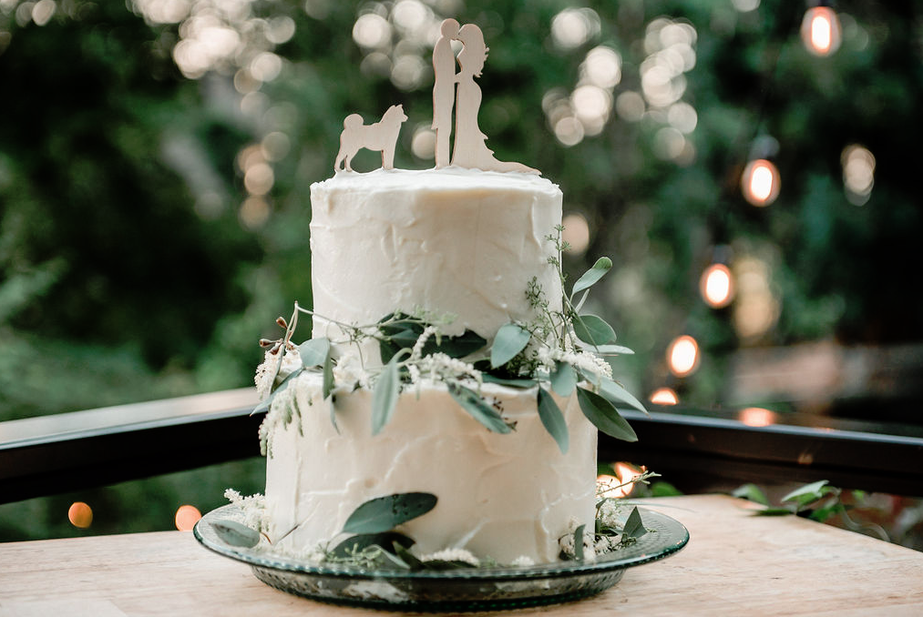 The wedding cake was a white buttercream one, with greenery and cutout toppers