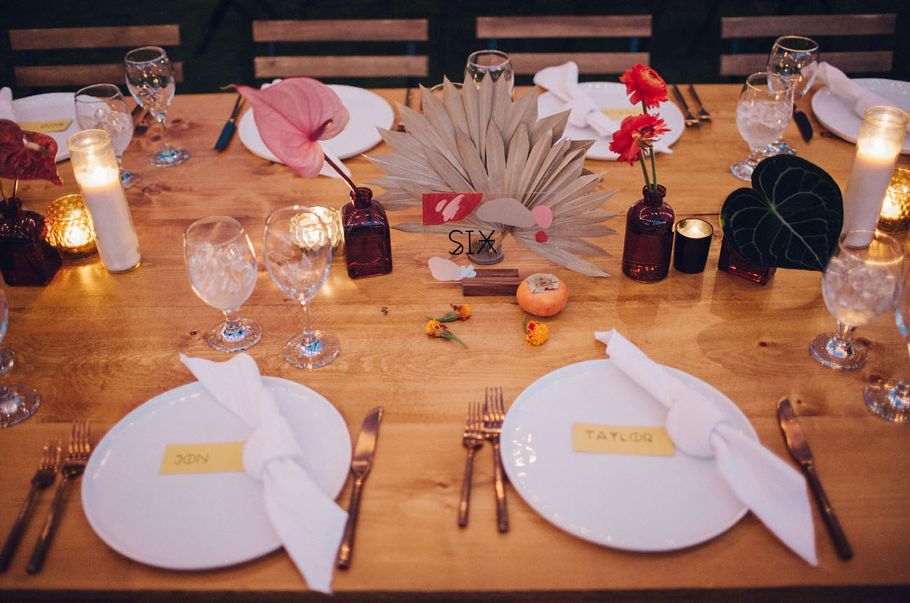 The wedding tablescapes were done with boho and desert touches, candles and bright blooms