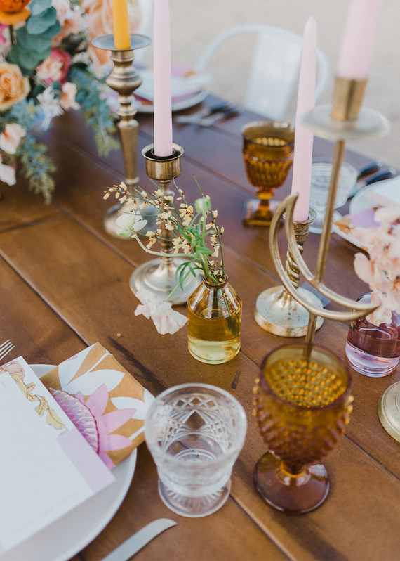 Elegant colored glasses, wildflowers, colroed candles helped to create an ambience