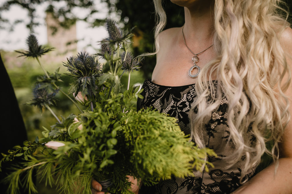 The bride was carrying a simple greenery and thistle wedding bouquet