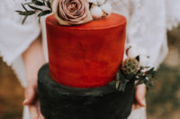 10 The wedding cake was a rust and black one, with greenery, a blush rose and cotton on top