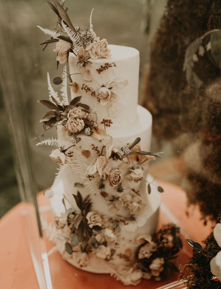 The wedding cake was a white one with dried blooms and herbs and leaves for a decadent feel