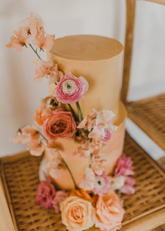 The wedding cake was a rust-colored one, with bright blooms for decor