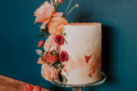 11 The wedding cake was textural and ombre coral, with fresh coral blooms on its side