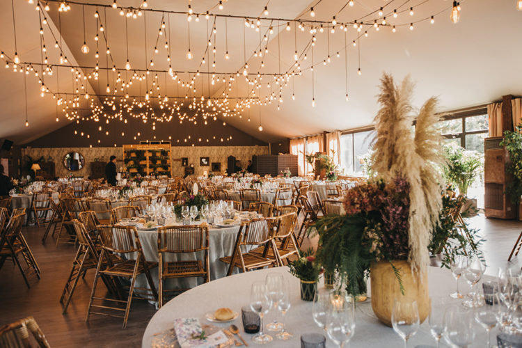 Lots of lights illuminated the wedding venue and rattan chairs completed the simple and cozy look