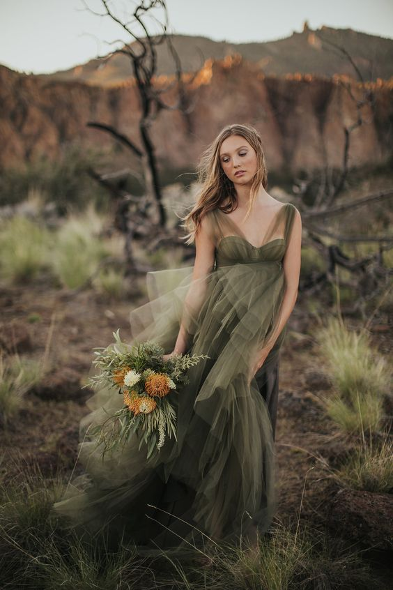 a moody green wedding dress with wide illusion straps, a sweetheart neckline and a layered tulle skirt for a moody fall bride