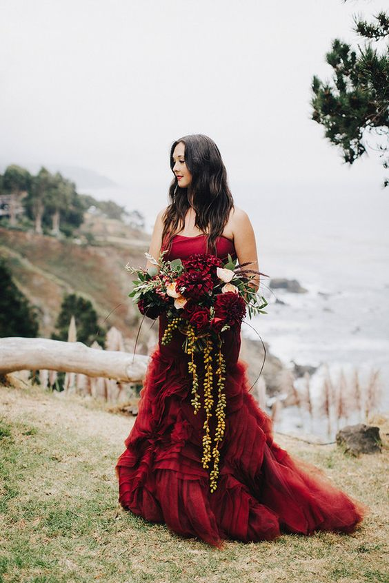 a strapless burgundy mermaid wedding dress with a layered skirt and a train is a timeless idea for the fall