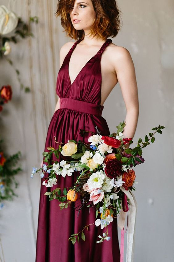 a burgundy wedding dress with a strap bodice and a pleated skirt plus an open back for a bold fall look
