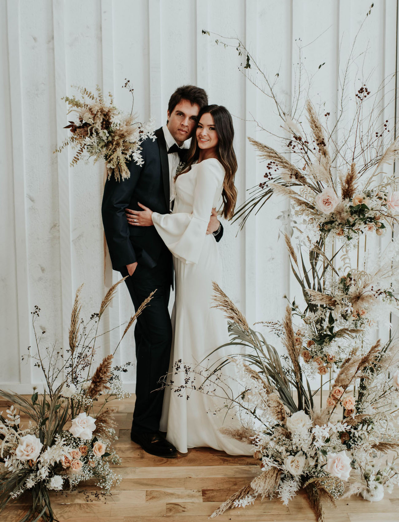 This black and white and muted tones wedding shoot was done with trendy dried flower arrangements