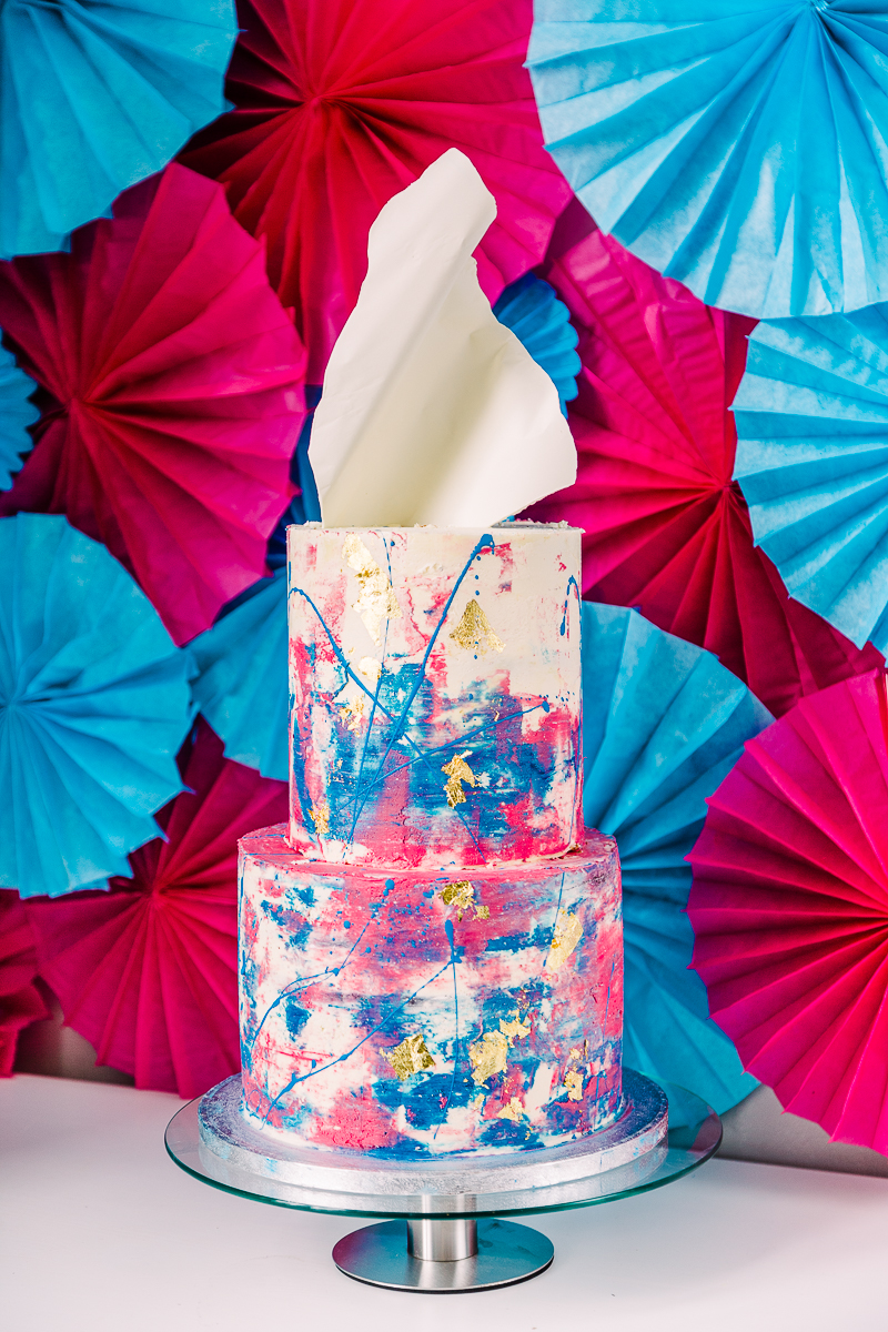 Look at this fantastic wedding cake with pink and blue brushstrokes and splashes of paint
