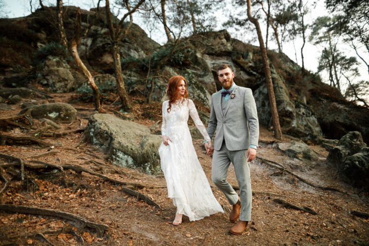 The bride was wearing a lace wedding dress with an illusion neckline, long sleeves and the groom was rocking a greye three-piece suit, an aqua shirt, a bow tie and Chelsea boots