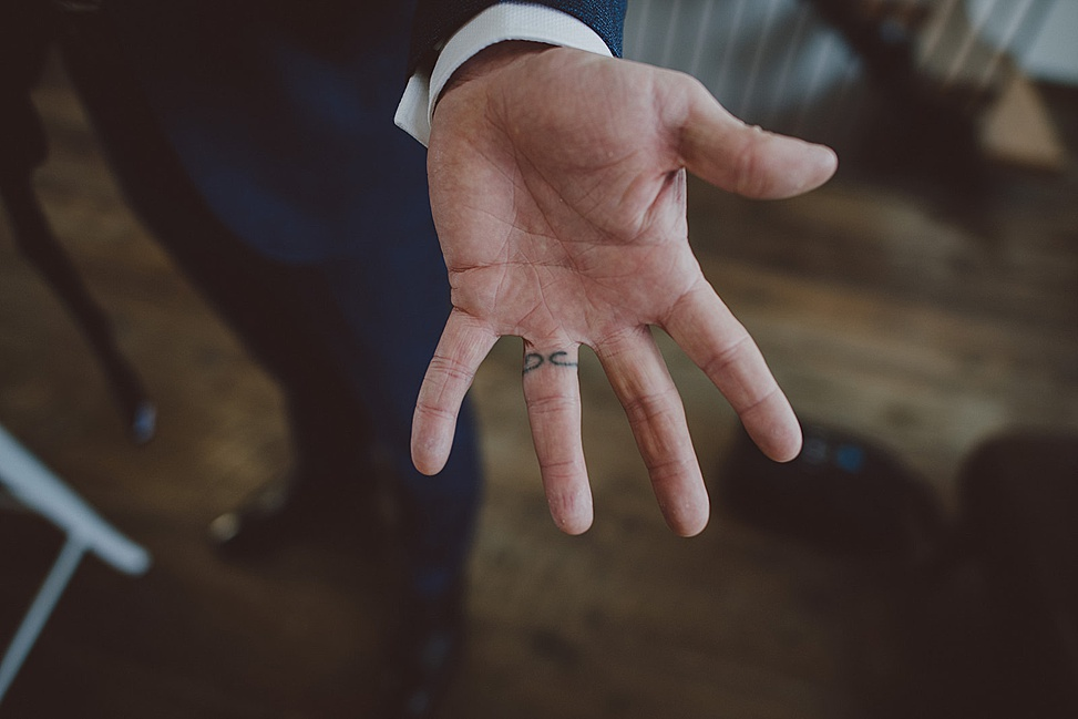 groom with a ring tattoo