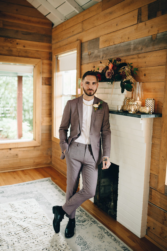 The groom was wearing a stylish printed suit, a white shirt and black shoes