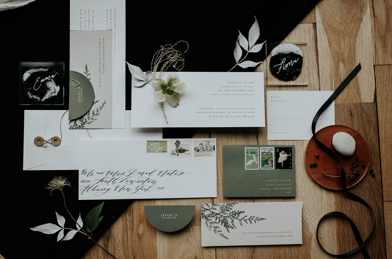 The stylish wedding invitation suite was done with grene touches and chic calligraphy