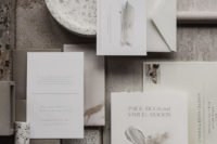 02 The wedding invitation suite is done in muted and neutral tones, with minimal aesthetics