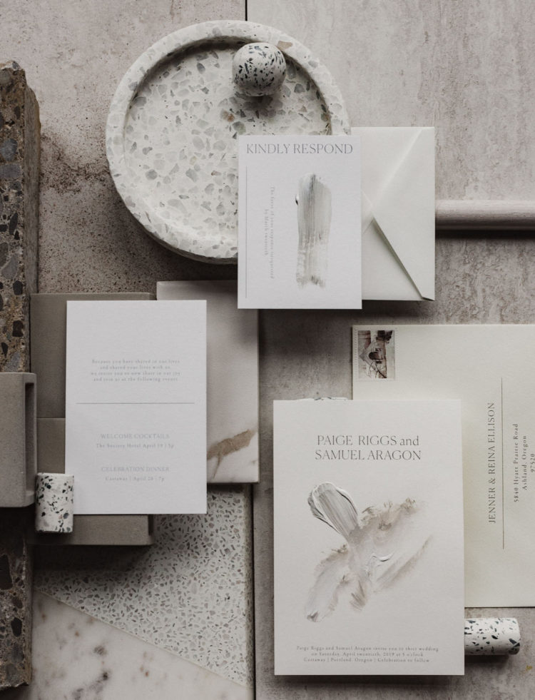 The wedding invitation suite is done in muted and neutral tones, with minimal aesthetics