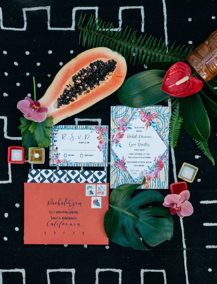 The wedding invitation suite was colorful and tropical, as it was a jungalow wedding