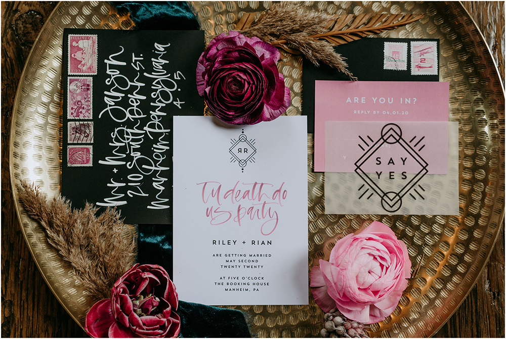 The wedding invitation suite was done with black and pink and modern calligraphy