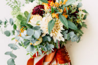 02 This lovely wedding bouquet was done with burgundy, orange and creamy blooms and a bright orange ribbon