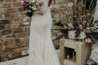 03 The bride was wearing a boho lace sheath wedding dress with long sleeves and a cutout back plus gorgeous headpieces