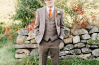 03 The groom was rocking a three-piece tweed suit with a bright orange tie and black shoes
