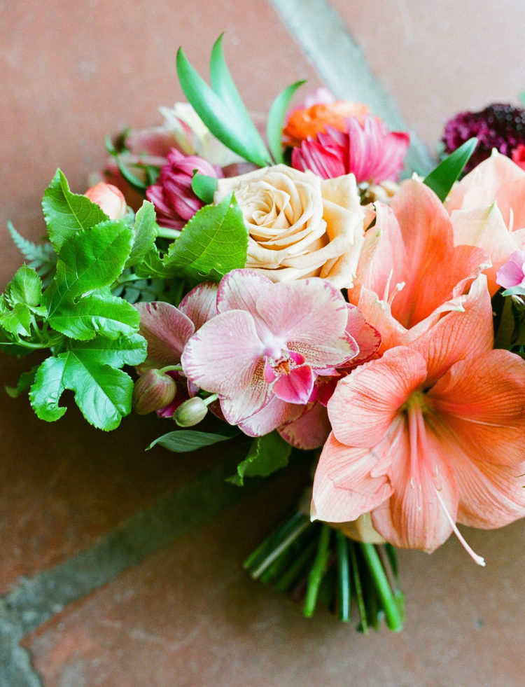 The wedding bouquet was done with hot pink and bright coral blooms and greenery