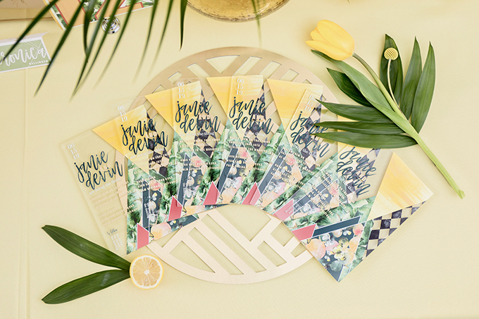 The wedding stationary was done with brights and tropical prints and touches of acryl for a mid-century modern feel