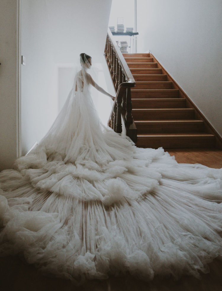 There was a super long train and a long veil that create a literal cloud around her