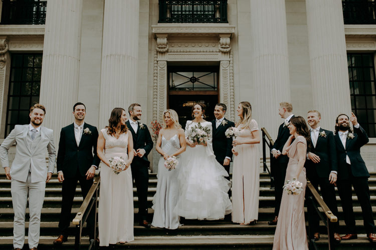 The bridesmaids were rocking mismatching blush dresses and the groomsmen were wearing the same as the groom