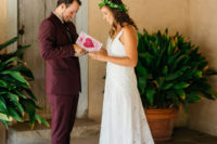 04 The groom was wearing a burgundy suit and black shoes, the bride was wearing a white boho lace A-line dress with a train