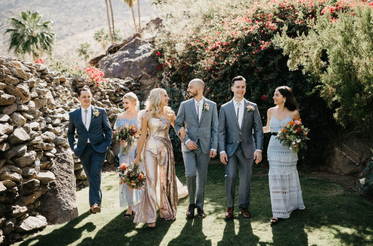 The groomsmen were wearing grey and blue suits, and the bridesmaids were rocking mismatched boho lace gowns