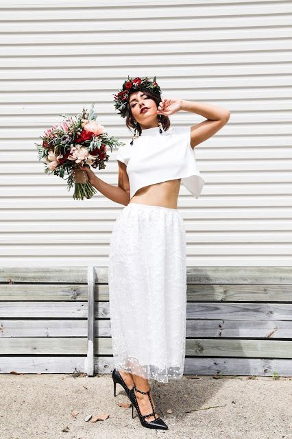 an ultra-modern bridal look with a plain white crop top, a polka dot midi skirt and edgy black studded shoes