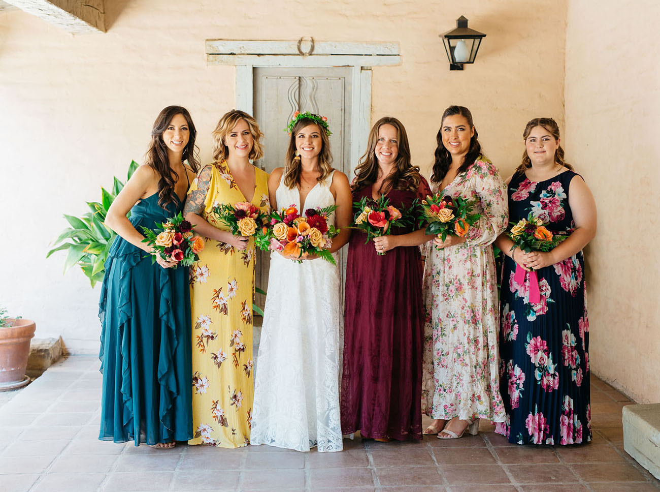 The bridesmaids were wearing mismatched floral and solid dresses