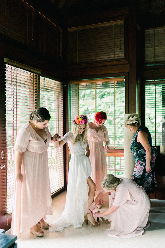 The bridesmaids were wearing matching blush high low dresses