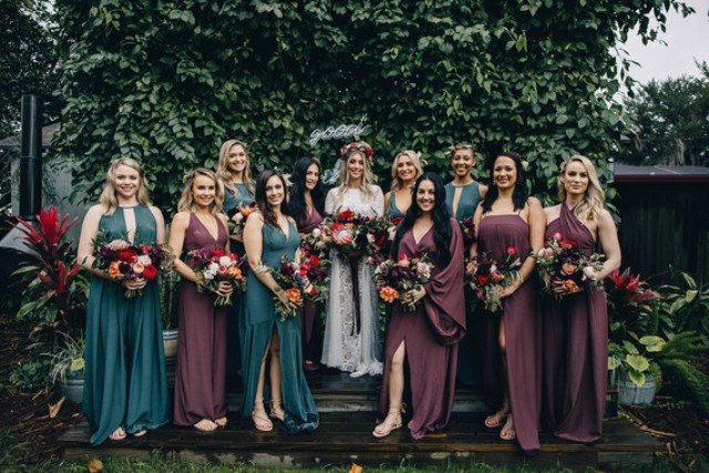 The bridesmaids were wearing plum and teal dresses, each chose her own dress